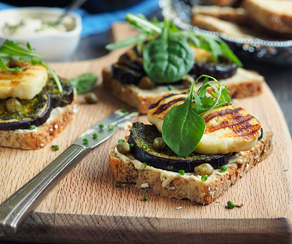 Photo of - Roasted Vegetable Tartine with Arugula Pesto and Grilled Halloumi